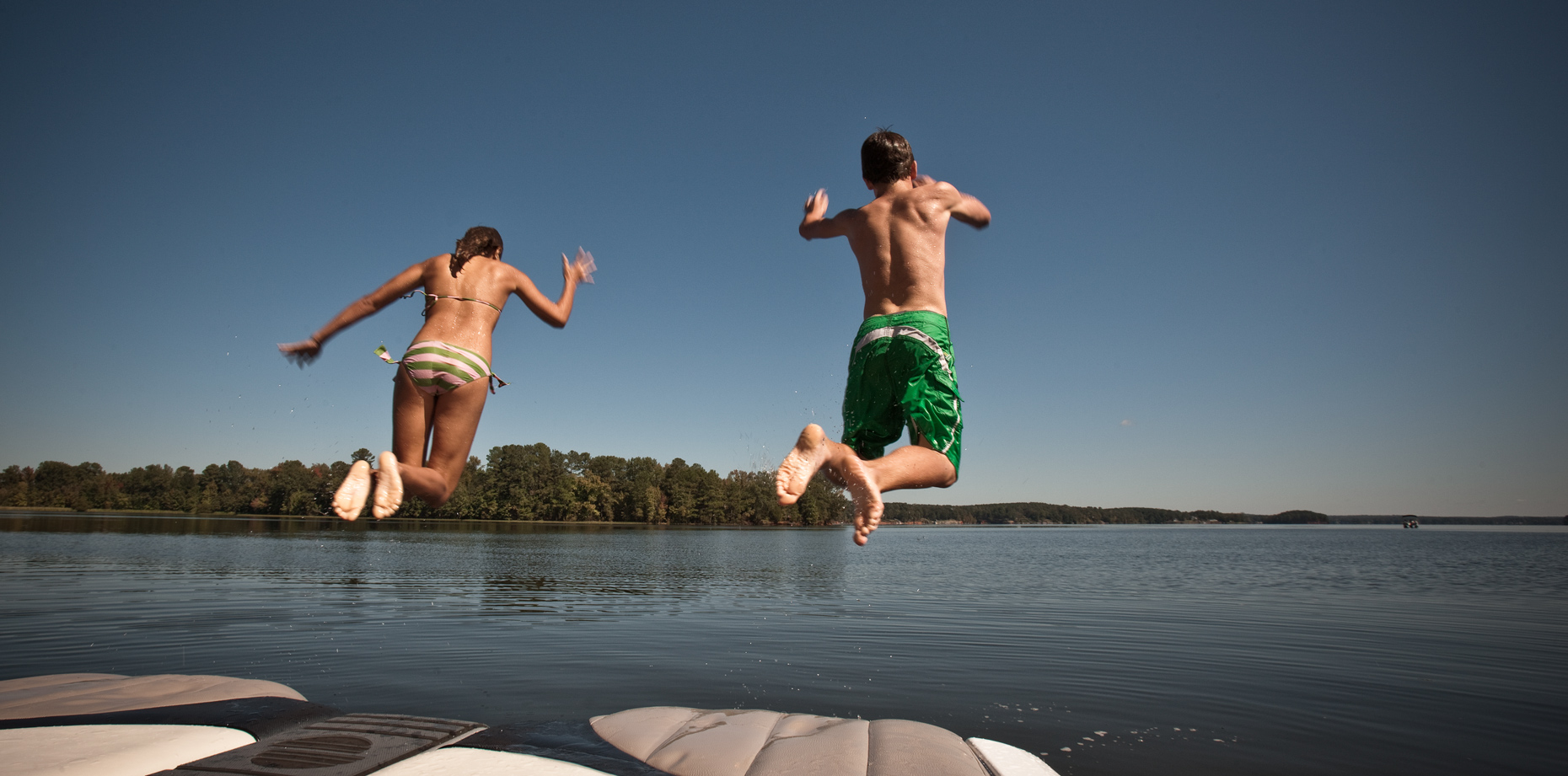 Jump-from-dock-lake